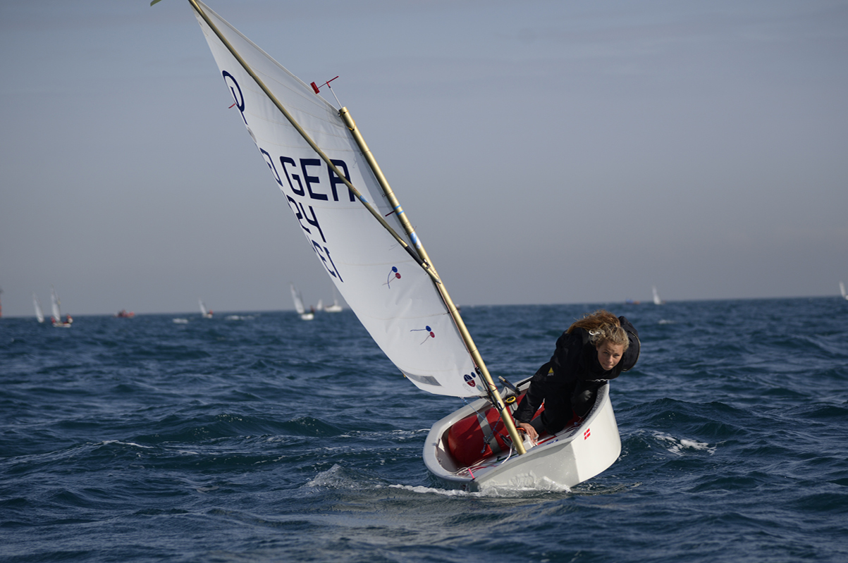 Deike Bornemann sailing in an Ullman Sails optimist.